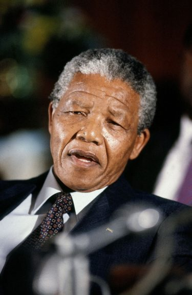 """Nelson Mandela is shown in this 1990 photo. (D. Michael Cheers/Ebony Collection)  View the entire EBONY Collection<strong><a href=""""http://www.ebony.com/store#axzz2PsEj7sec"""" target=""""_blank"""">here</a></strong>."""