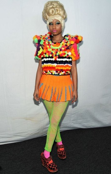 At the Carolina Herrera show, Nicki was in contrast with the traditional wardrobe that graced down the runway