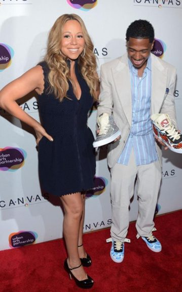 Nick Cannon and his lovely wife, Mariah Carey, hit the red carpet for the Project Canvas Charity in NYC in a blue striped button-down shirt to match his pair of blue Project Canvas kicks. Mariah stood by in black peep-toe pumps to match her black, zipper-front dress