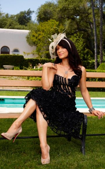 Prince's former wife, Mayte Garcia is just as pretty as he is! Sporting a black and nude dress with a lace bottom, church hat headband, and can't forget the Louboutin's, she looks amazing.