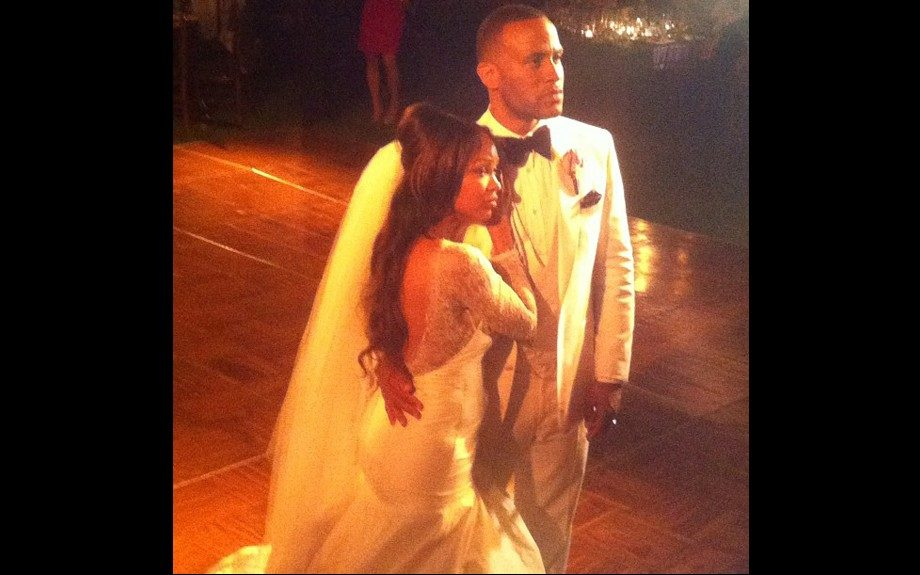 Meagan Good is lovely in a white custom-made R-Mine gown with a lace top, and long purple dipped train. DeVon looked dapper himself in white tuxedo, and dark purple bow tie