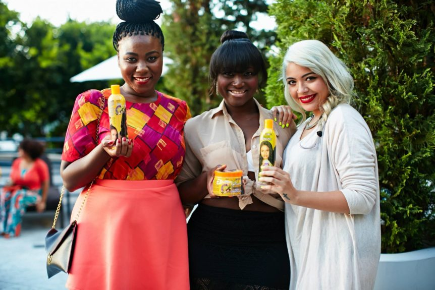 MegaGrowth rep Nyvia Weathersby, EBONY.com Beauty and Style coordinator Melanie Yvette Martin and attendee JudieReyes, stop and pose with the amazing products