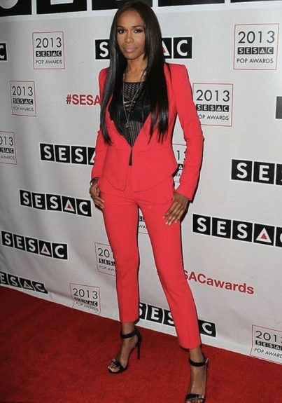Michelle Williams looks great at the 2013 SESAC Pop Music Awards in a fitted red suit, and black ankle strappy sandals. Photo Credit: WENN