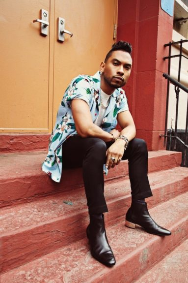 Even Miguel knows floral prints are in, and he's full of fashion in a shirt by Marc by Marc Jacobs, T-shirt by the Quality Mending Co., pants by Alexander McQueen, shoes by Saint Laurent with customized silver heels, and bracelets by The Great Frog and Shayan Afshar. Photo Credit: WireIma