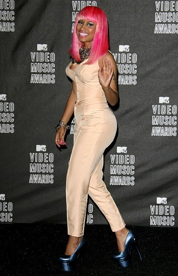 This is our favorite look form Nicki; at the MTV Music Awards she chose this peach body suit, with complimentary metallic heels and electric pink wig