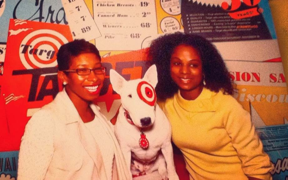 Target's50th Anniversary Celebration: Beauty editor Janell and Style editor Ericka taking a Target picture with Bullseye the Bull Terrier