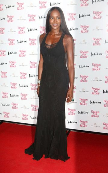 Naomi Campbell posed in her black floor-length Roberto Cavalli dress. Photo Credit: Getty