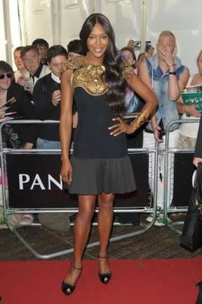 At the <em>Glamour</em> 2013 Women of the Year Awards, Naomi Campbell goes for gold in Alexander McQueen. Photo Credit: Getty