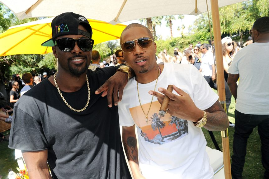 "Nas and Lance Gross celebrate the 20<sup>th</sup> anniversary of the ""Illmatic"" album at the Hennessy V.S brunch in Palm Springs during Coachella on April 13."