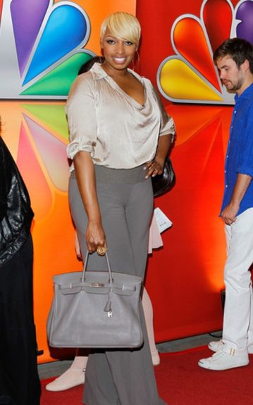 Nene Leakes kept it casual in grey on grey ensemble and swept her platinum blonde bangs to the side.