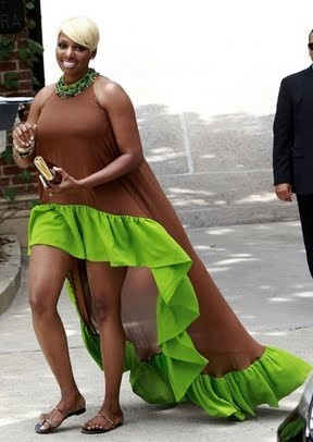 Nene Leakes headed to Kim Kardashian's baby shower in a brown and neon green hi-lo dress that we can't say we love. Photo Credit: WENN