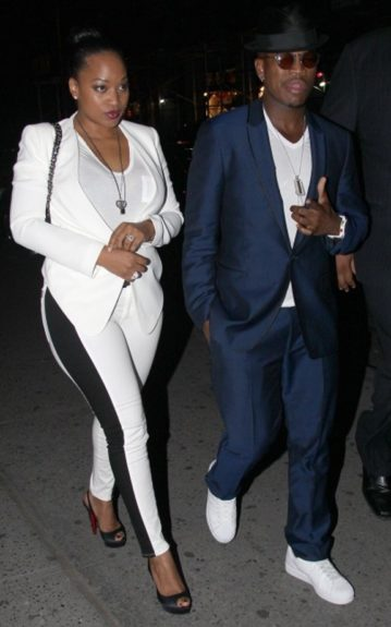 NeYo and his girl Monyetta Shaw head to the 40/40 looking spiffy. NeYo is in a shiny navy suit, and white v-neck shirt. Monyetta is in a white blazer, Rag & Bone Split Skinny Jeans, and black Louboutins