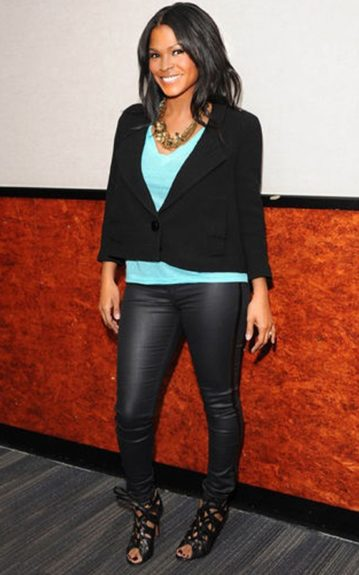 Nia Long looking beautiful as usual in a black blazer, aqua shirt and leather leggings with a firce pair of laced up sandals.