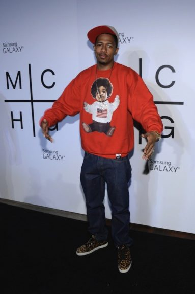 Nick Cannon mimicked the pose on his Biggie Polo sweatshirt that he paired with jeans, a fitted cap, and leopard sneaks. <em>photo: Getty</em>