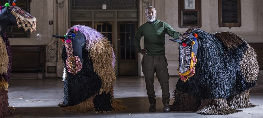 """Artist Nick Cave poses with his""""soundsuits"""";Photo Credit by Travis Magee, Courtesy Creative Time and MTA Arts for Transit"""