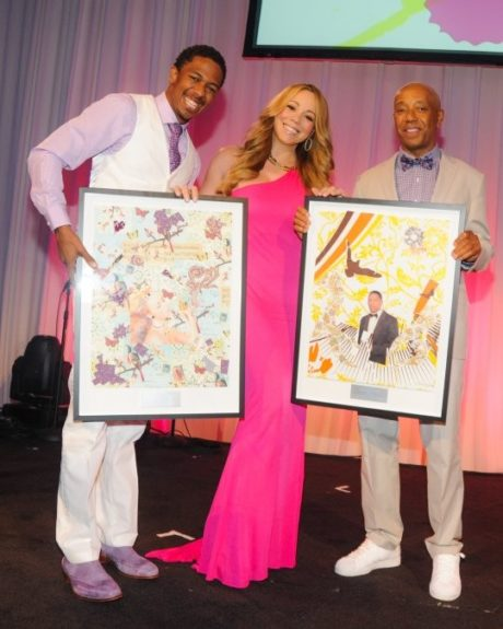 Nick Cannon wears a lavender button down, white vest, purple tie, white slacks, and lavender loafers. Mariah wears a floor-length fucshia evening gown, while Russell wears a gray suit, purple-checkered button down, with a purple bow tie. Photo Credit: Global Grind
