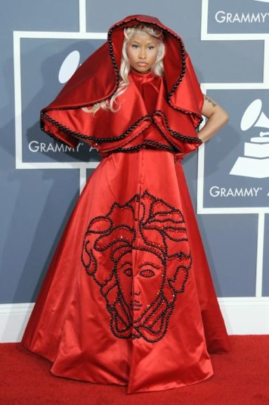 Going for 'religious couture', Nicki at the 2012 Grammys, wore this red Versace cape on the red carpet