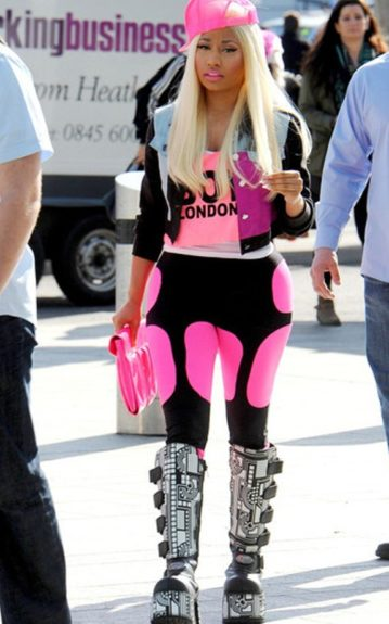 Nicki's last outfit in London this time around involved a pink cap, a cropped denim jacket over a bright pink cropped top, black and pink leggings and another pair of clunky platform boots.