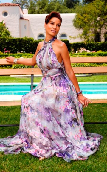 Ex-wife to Eddie Murphy, Nicole Murphy looks stunning in her colorful, floral halter dress.