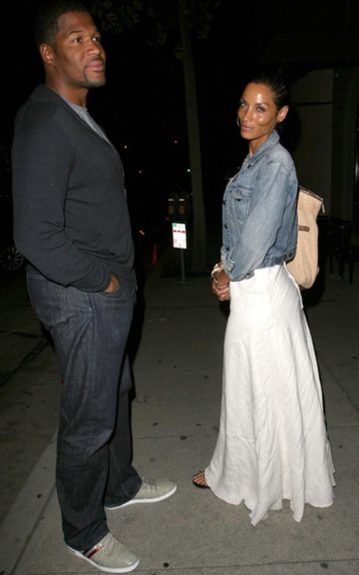 Michael Strahan posed in a black cardigan layered over a grey tee while Nicole Murphee went for a boho-chic ensemble in a white, floor-length dress with a denim jacket and an oversized tote.
