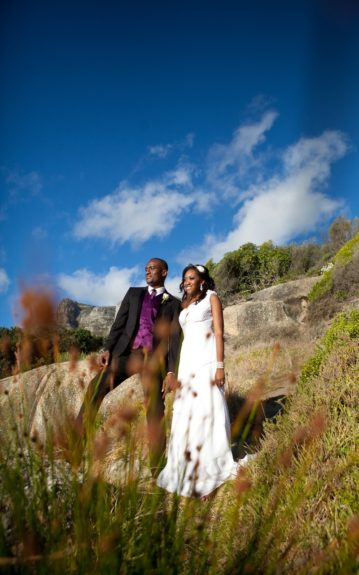 The couple Onyinye and Chima Gaiusand against an incredible South African landscape