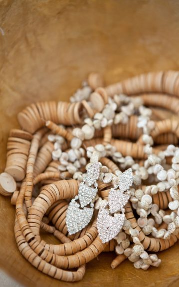 The Bride's Onyinye Gaius diamond studded earrings on a bed of wooden beads