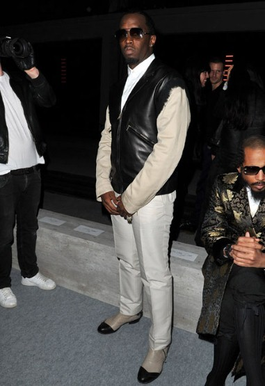 Diddy strikes a pose front row