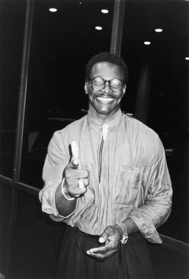 Walter Payton pose for the camera while attending the bout  between Mike Tyson and Michael Spinks in Atlantic City. (Bob Johnson/Ebony Collection 1988)