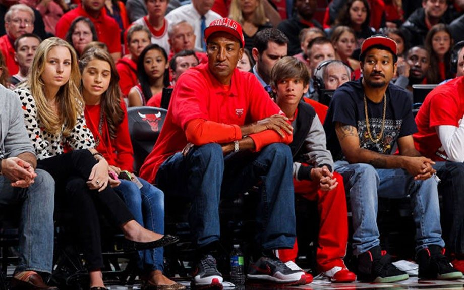 Scottie Pippen joined the red sea of Chicago Bulls fans in his former team's fitted hat and a Bulls polo over a long-sleeve red shirt at game one of the Eastern Conference quarterfinals during the 2012 NBA Playoffs