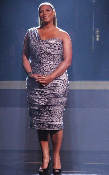Queen Latifah does it all in a short, one-sleeve, ruched dress with a busy print