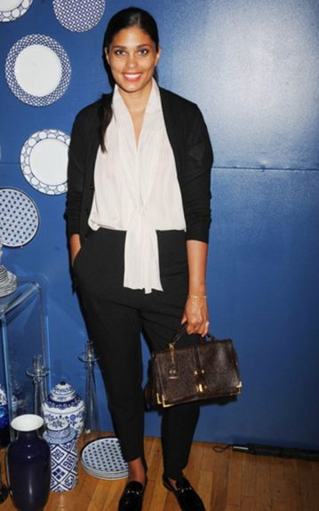 Designer Rachel Roy offsets her chic black and white ensemble with a brown and gold embellished handbag and red lip