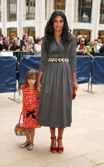 Rachel Roy kept it casual in a grey pinstripe tea length dress with a leopard print belt and res accessories.