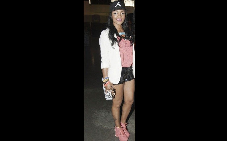 Rasheeda is all about A-town with an Atlanta Braves fitted, white blazer, black shorts, and Jeffery Campbell Lita spike boots