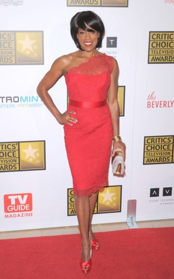 Regina looks gorgeous in a cherry one shoulder Lace Dress from Romona Keveza's Spring 2012 collection