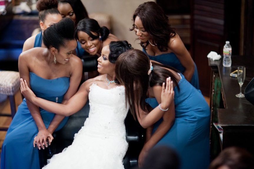 Nikky's bridesmaids crowd around their friend before her big moment