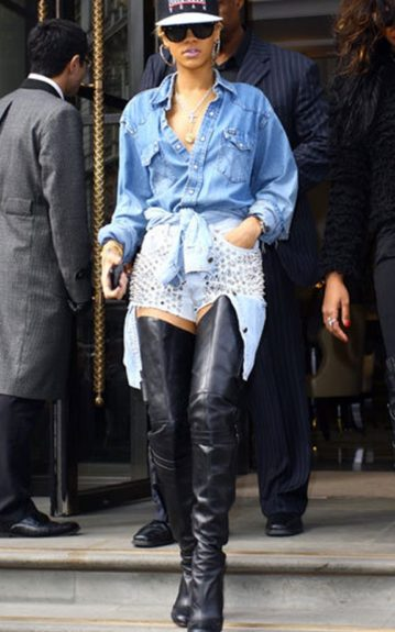 Rihanna and Kanye's great minds think alike as she too ties her light-washed denim top around a pair of light-washed denim shorts, only she studs her bottoms like a rockstar should