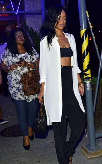 Rihanna did not turn her style down to take mom out for a Mother's Day meal, in fact the singer showed some skin in a black bralette with high-waist black slacks and a long, open white button-down to cover up-- just a tad. Mother, Monica Fenty, followed her high-fashion daughter's lead i