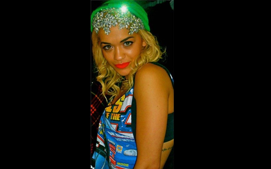Rita Ora doubled up on the headpieces, allowing her Jane Taylor Millinery Blossom Encrusted Headpiece to peek from underneath a lime green hat