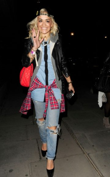 Rita Ora's red plaid shirt adds a pop of color to her outfit and ties in her red Chanel cross body bag. The black pumps add a ladylike touch and offset her ripped jeans