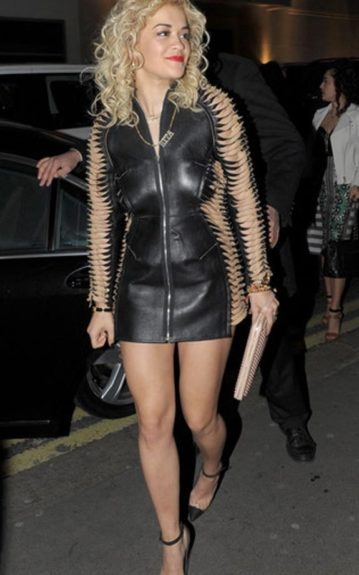 "Rita Ora kept busy as she celebrated the success of her hit song ""R.I.P."" in a leather zipper-front mini dress"