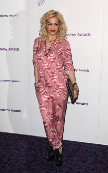 Rita Ora hit the Sony Radio Academy Awards in a red and white fun print pant suit.