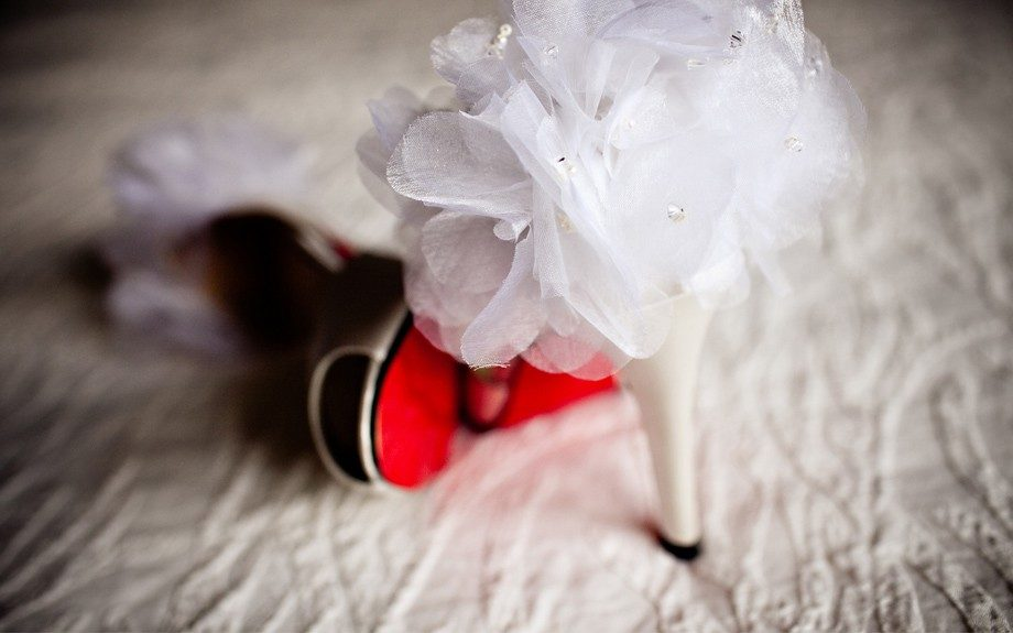Red Louboutins fitting for a bride