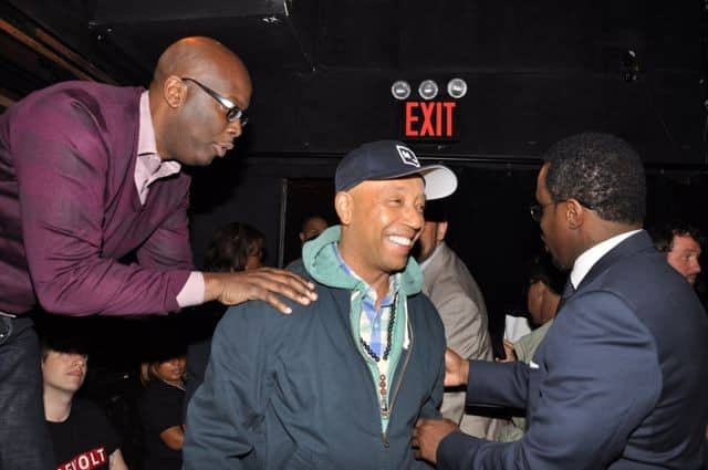 Sean Combs greets hip-hop mogul mentor Russell Simmons