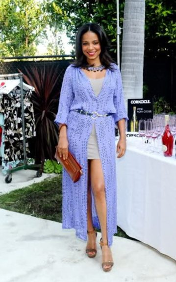 Sanaa looks lovely in her gray mini dress, long periwinkle knitted jacket, and brown sandal heels. Photo Credit: Splash