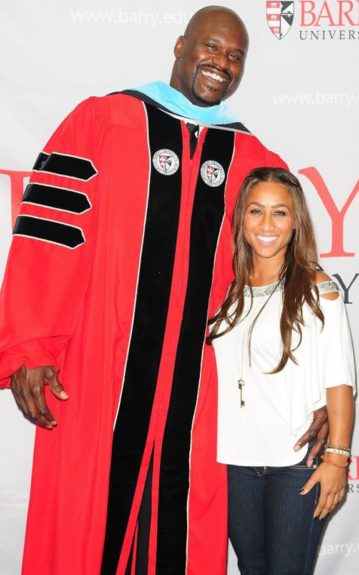Shaq' posed with girlfriend, Nicole Alexander in his graduation gown. She's a little under dressed for the occasion but his smile and major accomplishment are really all that matter