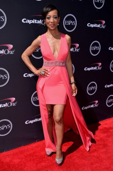 Shaun Robinson is gorgeous in this coral pink hi-lo gown