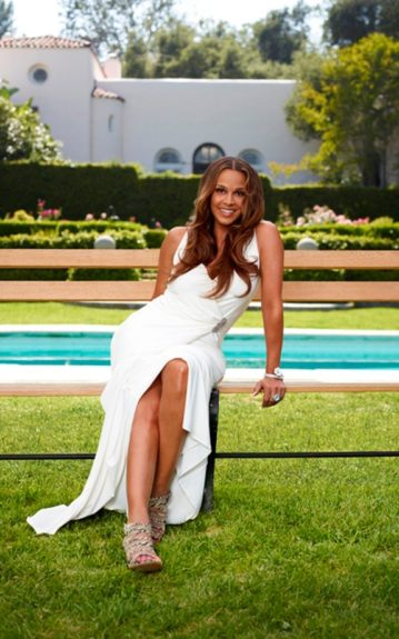 Sheree Fletcher was married to Will Smith for 3 years, and looks radiant in her white silted, floor length gown.