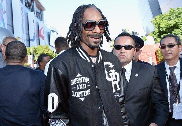 Snoop Lion opts for a varsity jacket and forgoes the formal wear. Oh, Uncle Snoop!