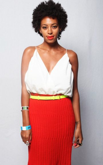 Not only does Solange color block with a neutral, white top and a bright, red skirt; she seals the deal with a neon, yellow belt.