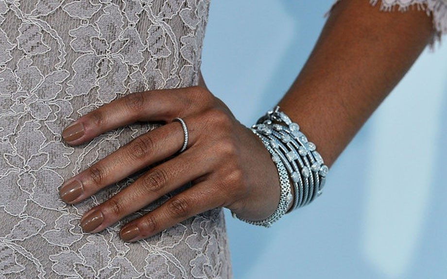 She wore silver David Yurman accessories and a nude manicure to compliment her nude lace Diane von Furstenberg dress
